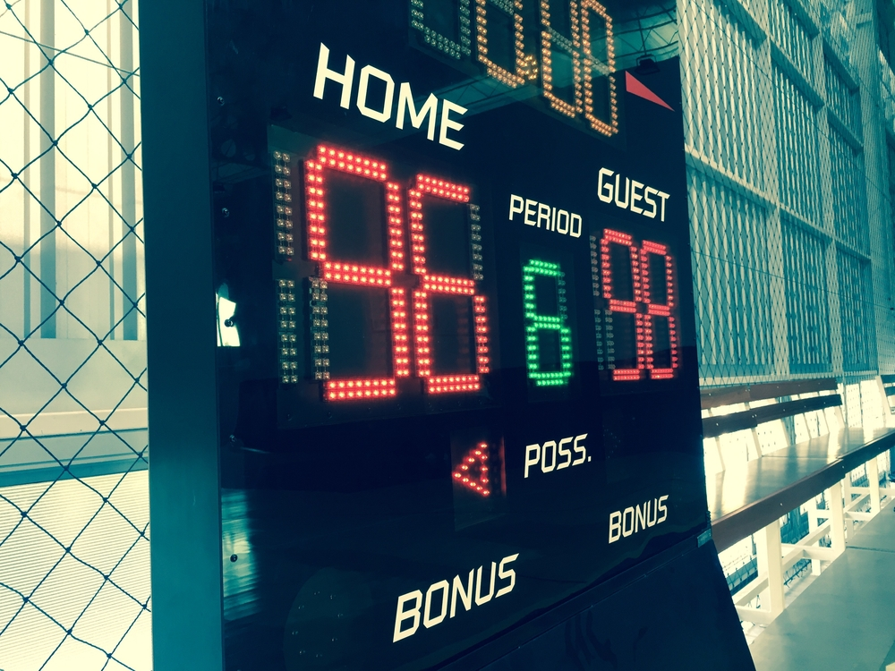 a score board with 98 for visitors and 96 to the home team